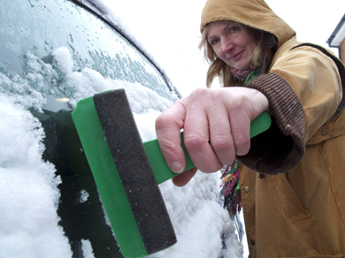 Scraping ice off of a car windscreen