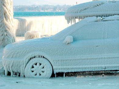 A frozen car covered in sheets of ice
