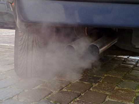 White smoke coming out of a car exhaust.